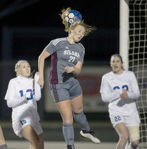 Ben Goff/NWA Democrat-Gazette Hailey Dorsey of Siloam Springs heads the ball off a corner kick Tuesday during the match against Rogers at Whitey Smith Stadium in Rogers.