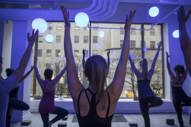 customers-take-a-yoga-class-offered-by-the-tishman-speyer-properties-zo-program-and-app-at-rockefeller-center-in-new-york-on-feb-26-2018-must-credit-victor-j-bluebloomberg
