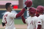 Arkansas first baseman Jordan McFarland (13) is congratulated by teammates after he hit a grand slam during a game against Kent State on Sunday, March 11, 2018, in Fayetteville.