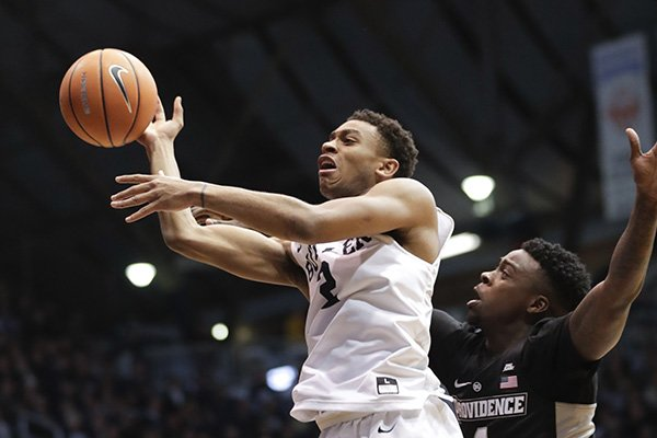 Butler guard Aaron Thompson (2) shoots in front of Providence guard Maliek White (4) in the first half of an NCAA college basketball game in Indianapolis, Saturday, Feb. 17, 2018. (AP Photo/Michael Conroy)