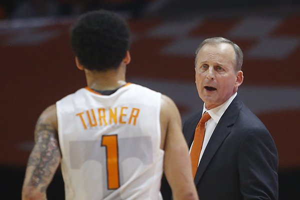 Tennessee coach Rick Barnes talks with guard Lamonte Turner (1) during the first half of the team's NCAA college basketball game against Florida on Wednesday, Feb. 21, 2018, in Knoxville, Tenn. (AP Photo/Crystal LoGiudice)