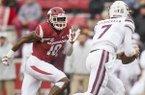Randy Ramsey, Arkansas linebacker, chases down Nick Fitzgerald, Mississippi State quarterback, in the second quarter Saturday, Nov. 18, 2017, at Reynolds Razorback Stadium in Fayetteville.