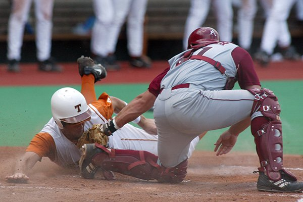 Arkansas catcher Brian Walker tags Texas base runner David Moroul during an NCAA Tournament game on June 6, 2005, in Austin, Texas. The Razorbacks and Longhorns are set to play two games this week after playing only five games since Arkansas left the Southwest Conference in 1991.