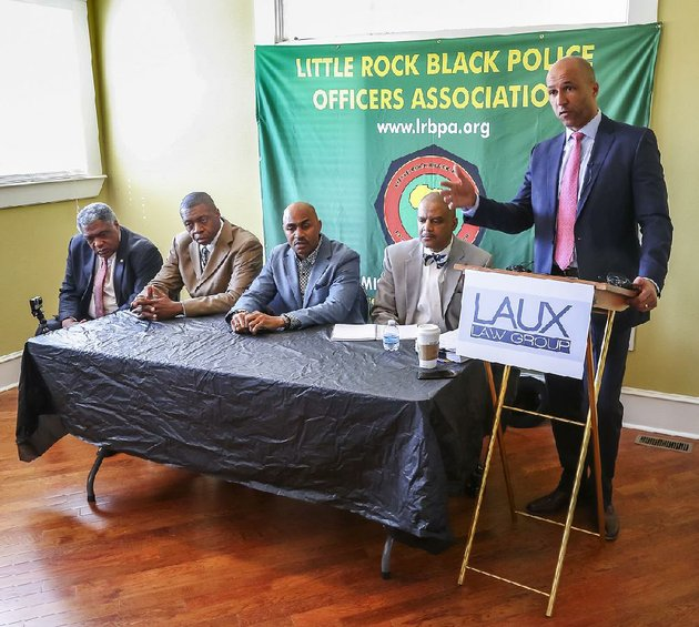 a-discrimination-lawsuit-was-filed-monday-against-little-rock-on-behalf-of-four-police-department-officers-by-attorney-mike-laux-standing-of-the-laux-law-group-seated-from-left-are-three-plaintiffs-lt-earnest-whitten-sgt-derrick-threadgill-and-sgt-willie-davis-along-with-lt-johnny-gilbert-jr