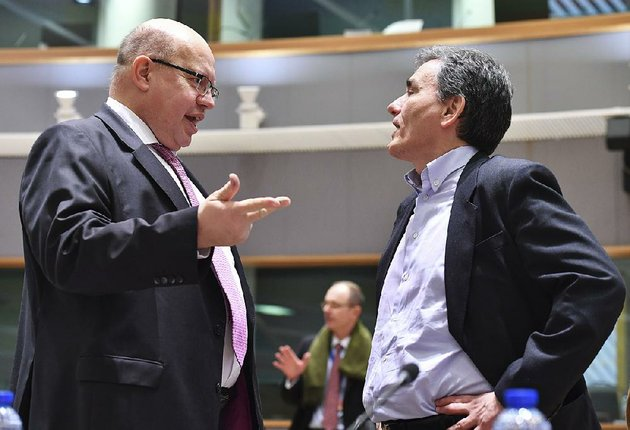 peter-altmaier-left-germanys-acting-chief-of-finance-speaks-monday-with-greek-finance-minister-euclid-tsakalotos-during-a-meeting-in-brussels
