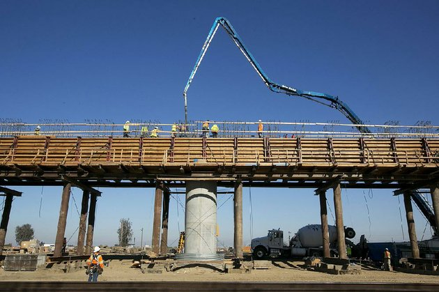 workers-pour-concrete-onto-an-elevated-section-of-the-high-speed-rail-line-that-will-cross-the-san-joaquin-river-near-fresno-calif-in-this-december-photo