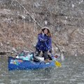 Amanda Kay Whelchel-Harris stands Feb. 5 to find a floatable channel on the Meramec River as a snow ...