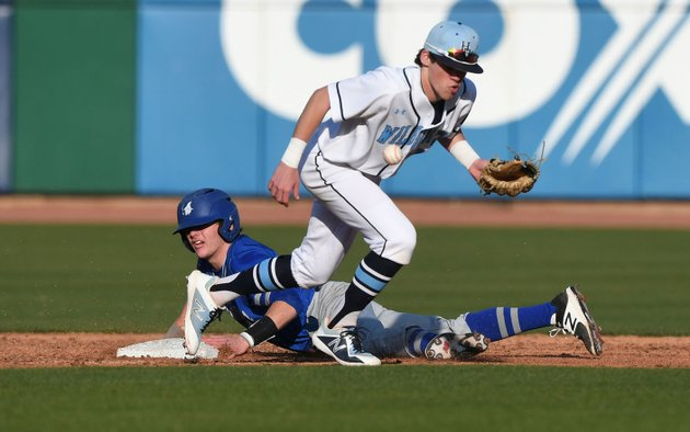 nwa-democrat-gazettejt-wampler-springdale-har-bers-mac-mccroskey-cant-keep-a-hold-of-the-ball-while-rogers-brandon-husted-slides-to-second-base-monday-march-12-2018-at-arvest-ballpark-in-springdale-rogers-beat-the-wildcats-1-0