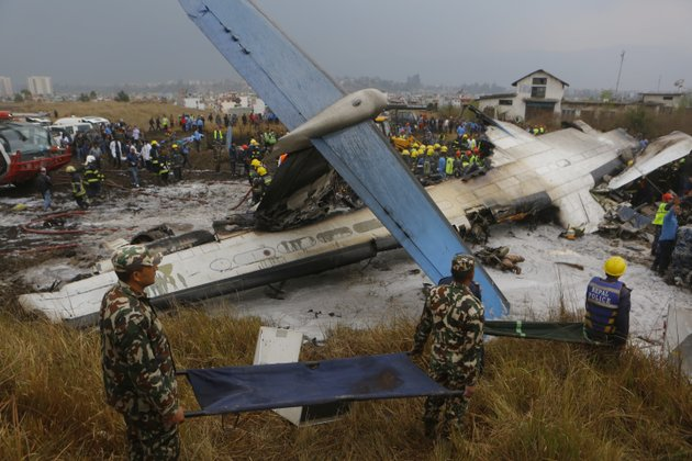 nepalese-rescuers-work-after-a-passenger-plane-from-bangladesh-crashed-at-the-airport-in-kathmandu-nepal-monday-march-12-2018-the-passenger-plane-carrying-71-people-from-bangladesh-crashed-and-burst-into-flames-as-it-landed-monday-in-kathmandu-nepals-capital-killing-dozens-of-people-officials-said-ap-photoniranjan-shreshta
