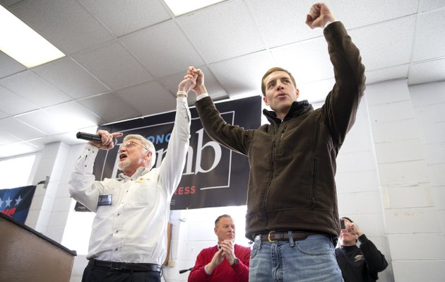 cecil-roberts-president-of-the-united-mine-workers-left-lifts-up-democratic-candidate-conor-lambs-hand-as-the-crowd-erupts-in-cheers-and-chants-during-a-rally-sunday-march-11-2018-at-the-greene-county-fairgrounds-in-waynesburg-pa-lamb-is-running-against-state-rep-rick-saccone-for-pennsylvanias-18th-congressional-district-in-a-special-election-on-tuesday-antonella-crescimbenipittsburgh-post-gazette-via-ap