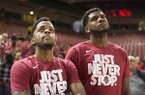 Arkansas Razorbacks guard Daryl Macon (left) and forward Trey Thompson (right) watch the NCAA selection show, Sunday, March 11, 2018 at Bud Walton Arena in Fayetteville. The Razorbacks will play Butler in Detroit on Friday