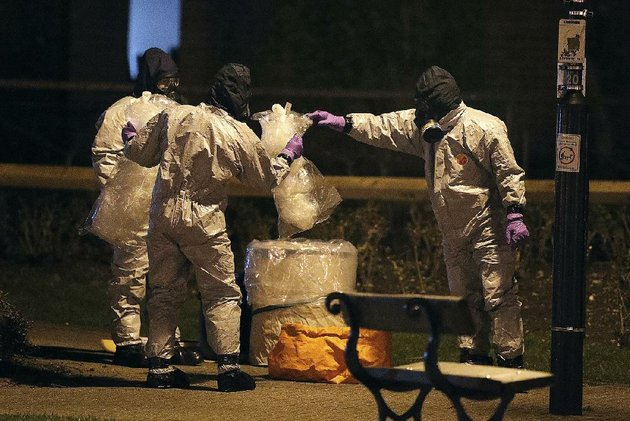 investigators-in-protective-suits-work-tuesday-at-the-maltings-shopping-center-in-salisbury-england-near-where-a-nerve-agent-was-used-to-poison-former-spy-sergei-skripal-and-his-daughter