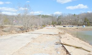 Keith Bryant/The Weekly Vista The walkable surface of the Lake Bella Vista dam was washed away in February's flood.