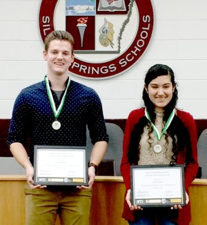Janelle Jessen/Herald-Leader High school seniors Seth Hufford and Karla Pena were recognized at the March 8 school board meeting for receiving the Northwest Arkansas Regional Student Career & Technical Leadership Award. Both recipients received the award at the Northwest Arkansas Regional Career Day in February and are eligible to receive a $1,000 scholarship from the Northwest Arkansas Community College or a one semester tuition waiver from Northwest Technical Institute upon high school graduation. Pena is a completer in business and family consumer sciences and is involved in FCCLA and FBLA. She will be attending FCCLA nationals in June to compete in the early childhood division. She attended FCCLA nationals as a junior and competed in entrepreneurship. She is a member of the Arvest Junor Bank Board and plans to attend NWACC in the fall to major in business administration. Hufford is a completer in plant and animal science. He is involved in FFA and shows hogs at the county fair through FFA. He will attend NWACC this fall with intentions of transferring to the University of Arkansas after two years to major in poultry science with a minor in agribusiness.