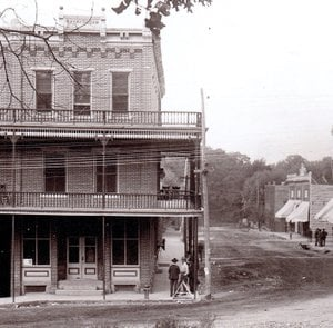 Photo courtesy of the Siloam Springs Museum An old picture of the intersection of Broadway and University Streets taken shortly after 1899 shows the Morris/Youree Hotel building on the left while the third floor and balconies were still intact. The Victorian Tea Party will be held in the Courtyard Event Center, which is in the basement of the historic building.