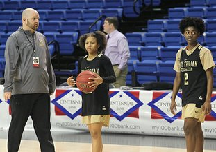 The Sentinel-Record/Richard Rasmussen ALL-STATE DUO: Hot Springs girls' basketball coach Josh Smith, left, works with senior Lady Trojan guards Ariana Guinn, center, and Imani Honey Friday at Bank of the Ozarks Arena before their Class 5A state championship victory over Watson Chapel on Saturday.