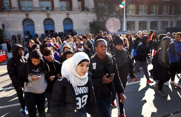 hundreds-of-students-walk-out-of-midwood-high-school-as-part-of-a-nationwide-protest-against-gun-violence-wednesday-march-14-2018-in-the-brooklyn-borough-of-new-york-it-is-the-nations-biggest-demonstration-yet-of-the-student-activism-that-has-emerged-in-response-to-last-months-massacre-of-17-people-at-floridas-marjory-stoneman-douglas-high-school-ap-photomark-lennihan