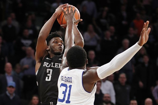 Butler guard Kamar Baldwin (3) shoots over Seton Hall center Angel Delgado (31) in the waning seconds of an NCAA college basketball game in the Big East men's tournament quarterfinals in New York, Thursday, March 8, 2018. Butler upset Seton Hall 75-74. (AP Photo/Kathy Willens)