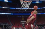 Arkansas center Daniel Gafford goes up for a dunk during practice Thursday, March 15, 2018, at Little Caesars Arena in Detroit.