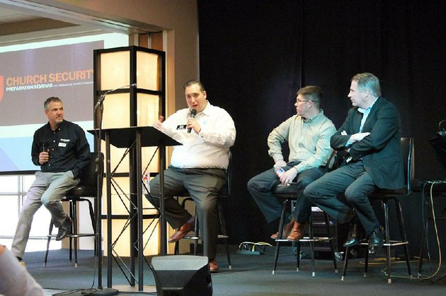 travis-story-second-from-left-of-story-law-firm-in-fayetteville-speaks-during-a-question-and-answer-panel-at-the-church-security-preparation-seminar-hosted-by-the-arkansas-baptist-convention-at-park-hill-baptist-church-in-north-little-rock-on-monday-story-along-with-the-conventions-assistant-executive-director-greg-addison-left-sherwood-police-officer-jeff-hagar-and-north-little-rock-police-chief-mike-davis-each-led-topic-sessions-at-the-seminar