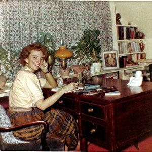 Madeleine L'Engle sits at her desk in this undated photograph.