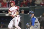 Arkansas catcher Grant Koch hits a home run during a game against Kentucky on Friday, March 16, 2018, in Fayetteville.