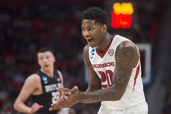 Arkansas forward Darious Hall claps after dunking the ball during an NCAA Tournament game against Butler on Friday, March 16, 2018, in Detroit.
