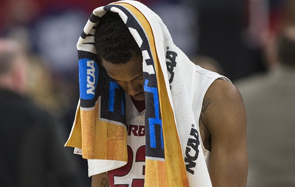 Arkansas guard C.J. Jones walks off the court following a loss to Butler in the NCAA Tournament on Friday, March 16, 2018, in Detroit.