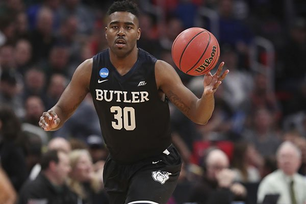 Butler forward Kelan Martin brings the ball up court during the first half of a first round game in the NCAA college basketball tournament against Arkansas, Friday, March 16, 2018, in Detroit. (AP Photo/Carlos Osorio)