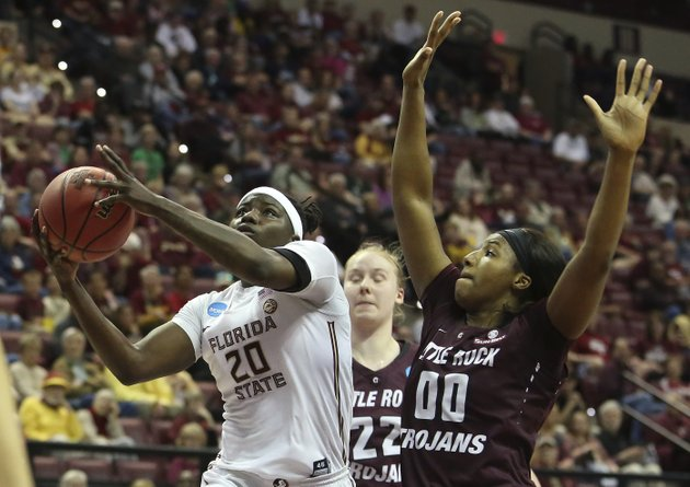 florida-states-shakayla-thomas-gets-around-the-defense-of-arkansas-little-rocks-ronjanae-degray-to-score-in-a-first-round-game-of-the-ncaa-womens-college-basketball-tournament-saturday-march-17-2018-in-tallahassee-fla-ap-photosteve-cannon