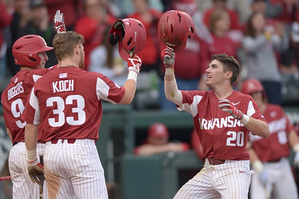 Arkansas second baseman Carson Shaddy (20) is congratulated after hitting a home run during a game against Kentucky on Saturday, March 17, 2018, in Fayetteville.