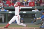 Arkansas outfielder Eric Cole hits a home run during a game against Kentucky on Friday, March 16, 2018, in Fayetteville.