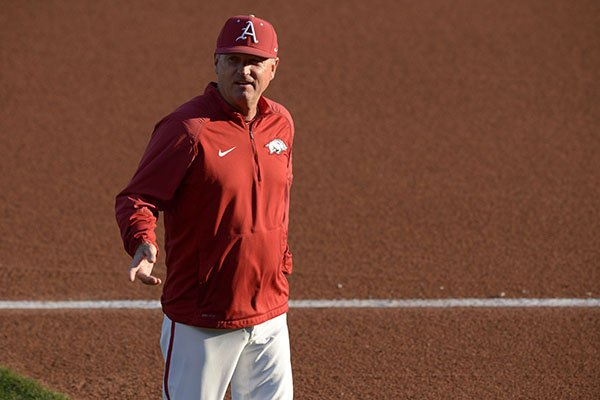 Arkansas coach Dave Van Horn walks the field prior to a game against Kentucky on Friday, March 16, 2018, in Fayetteville.