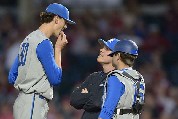 Kentucky pitcher Sean Hjelle, left, looks down to assistant coach Jim Belanger and catcher Troy Squires during a game Friday, March 16, 2018, in Fayetteville. Hjelle is 6-11.