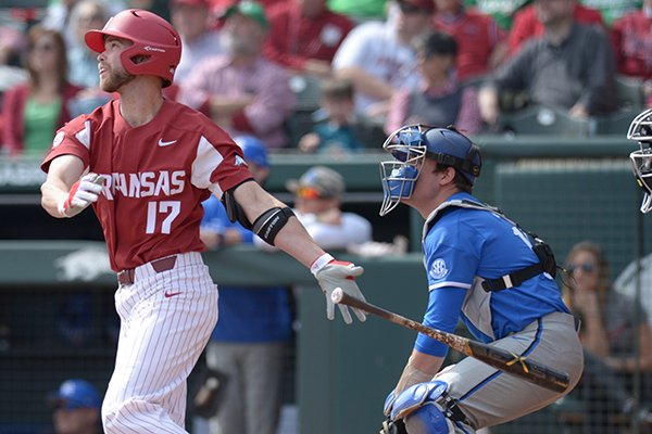 Arkansas' Luke Bonfield (17) hits a home run during a game against Kentucky on Saturday, March 17, 2018, in Fayetteville.