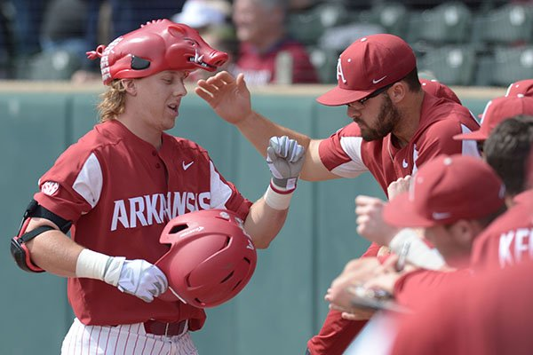 Arkansas outfielder Eric Cole is greeted after he hit a home run during a game against Kentucky on Saturday, March 17, 2018, in Fayetteville.