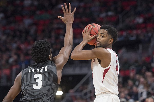 Arkansas guard Daryl Macon is defended by Butler guard Kemar Baldwin during a NCAA Tournament game Friday, March 16, 2018, in Detroit.