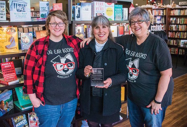 main-street-arkansas-recognized-dog-ear-books-recently-with-the-best-downtown-retail-award-betsy-mcguire-executive-director-of-main-street-russellville-center-celebrates-with-dog-ear-books-owners-emily-young-left-and-her-mother-pat-young-right
