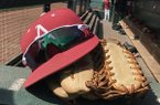 An Arkansas baseball hat and glove sit in the dugout prior to a game between the Razorbacks and Kentucky on Saturday, March 17, 2018, in Fayetteville.