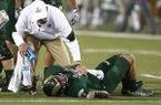 Colorado State quarterback Collin Hill is tended to by trainer after being injured while carrying the ball against the Utah State in the second half of an NCAA college football game Saturday, Oct. 8, 2016, in Fort Collins, Colo. Colorado State won 31-24. (AP Photo/David Zalubowski)