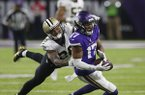 Minnesota Vikings wide receiver Jarius Wright (17) makes a catch in front of New Orleans Saints cornerback P.J. Williams (26) during the second half of an NFL divisional football playoff game in Minneapolis, Sunday, Jan. 14, 2018. (AP Photo/Jim Mone)