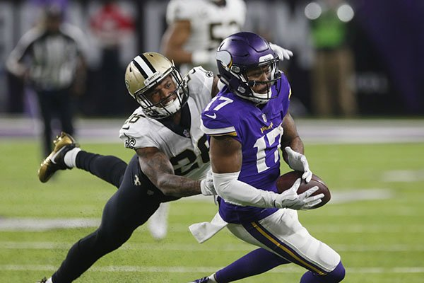 minnesota-vikings-wide-receiver-jarius-wright-17-makes-a-catch-in-front-of-new-orleans-saints-cornerback-pj-williams-26-during-the-second-half-of-an-nfl-divisional-football-playoff-game-in-minneapolis-sunday-jan-14-2018-ap-photojim-mone