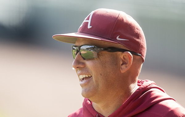 Arkansas pitching coach Wes Johnson watches practice Tuesday, Oct. 11, 2017, in Fayetteville.