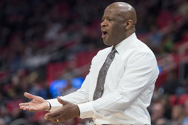Mike Anderson, Arkansas head coach, coaches in the second half against Butler Friday, March 16, 2018, in the first round of the NCAA Tournament at Little Caesars Arena in Detroit.