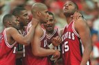 From left to right, Arkansas basketball players Clint McDaniel, Scotty Thurman, Corliss Williamson, Corey Beck and Dwight Stewart huddle during the Razorbacks' 1995 SEC Tournament championship game loss to Kentucky on Sunday, March 12, 1995, in Atlanta.
