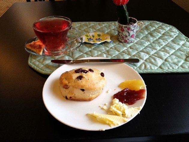 a-cup-of-fruity-blueberry-lemongrass-tea-and-a-cranberry-pecan-scone-with-all-the-spreads-is-perfect-for-a-rainy-afternoon-snack-at-abbis-teas-things