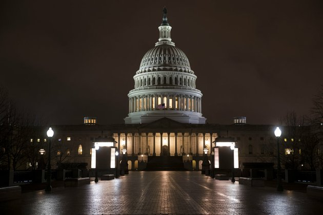 the-capitol-is-seen-before-dawn-wednesday-after-a-night-of-negotiating-on-the-government-spending-bill-in-washington-march-21-2018