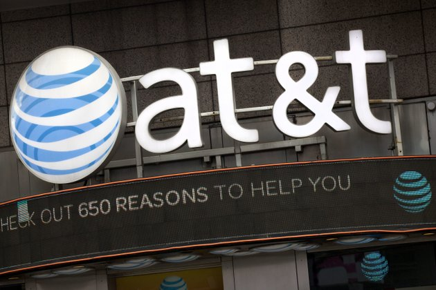 in-this-oct-24-2016-file-photo-the-att-logo-is-positioned-above-one-of-its-retail-stores-in-new-york