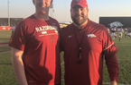 2020 offensive lineman Chad Lindberg and Arkansas offensive line coach Dustin Fry.