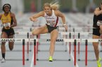 Arkansas' Payton Stumbaugh (center) leads Valerie Thames of Missouri (left) and Alex Gochenour Saturday, April 22, 2017, in the 100-meter hurdles during the John McDonnell Invitational at John McDonnell Field in Fayetteville.